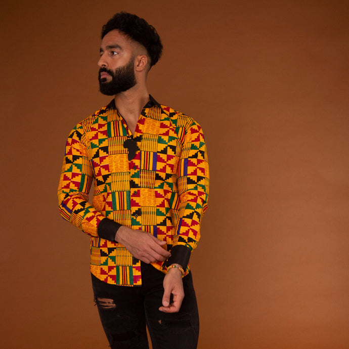 Yellow kente collared shirt with black crepe trim on the collar and sleeve