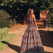 Load image into Gallery viewer, Beautiful Black lady with a scrappy brown crop top and a billowing skirt in the sun surrounded by trees and smiling