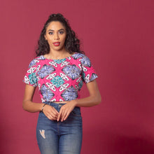 Load image into Gallery viewer, African print crop top made from hand selected ankara wax print in a striking pink, blue and white pattern