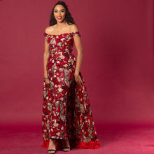 Load image into Gallery viewer, Red floor-length Ankara wax print dress in floral pattern featuring a sweetheart neckline and off-shoulder straps. This dress can be coupled with a matching cape belt.