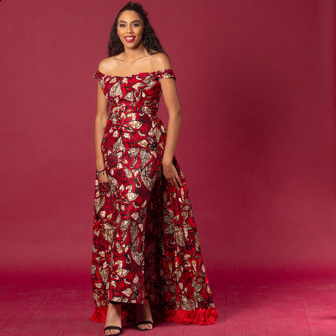 Red floor-length Ankara wax print dress in floral pattern featuring a sweetheart neckline and off-shoulder straps. This dress can be coupled with a matching cape belt.