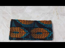 Load and play video in Gallery viewer, Video of African print face mask in a green and orange geometric ankara wax print fabric against a marble background