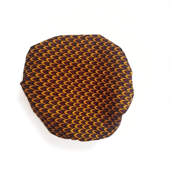 African print satin lined bonnet made from yellow and burgundy ankara wax print