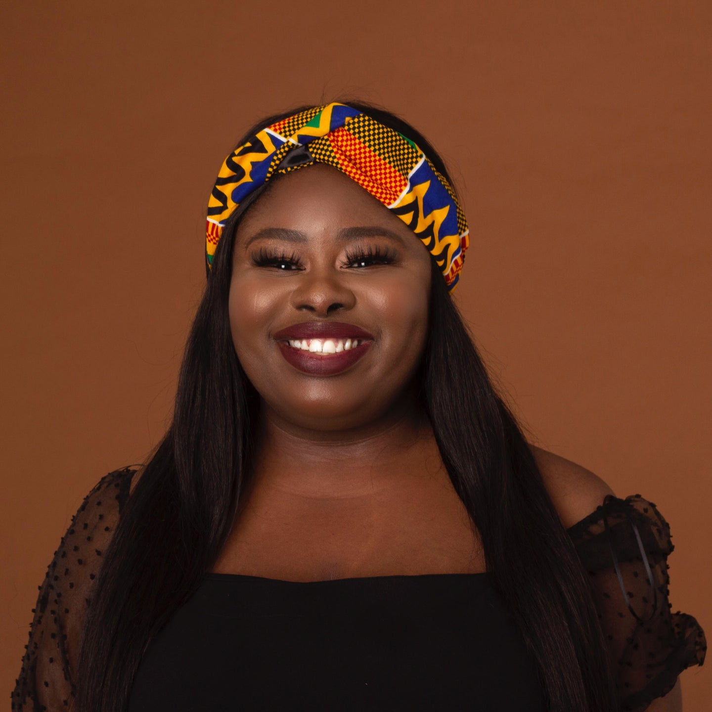 African print criss cross turban style headband made from kente wax print