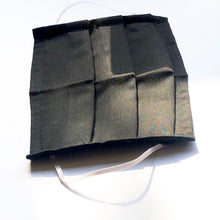 Load image into Gallery viewer, Matte Black Cotton Mask with four layers of fabric and white elastic ear loops laid vertically against a white background