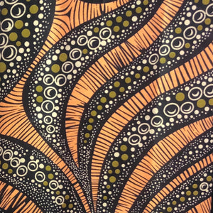 Brown and orange african print ankara fabric in white and green bubble pattern