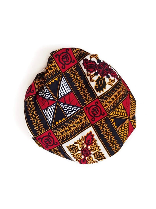 African print satin lined bonnet hand-made from red, yellow, white and black ankara wax print in a geometric pattern
