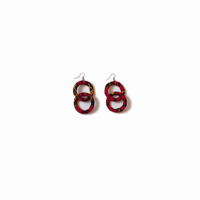 Red, black and yellow African wax print double hoop earrings with silver tone hook on a white background
