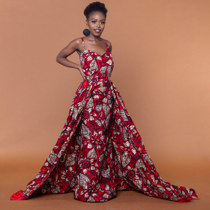 Red floor-length African print dress in floral pattern featuring a sweetheart neckline and off-shoulder straps. This dress can be coupled with a matching cape belt.