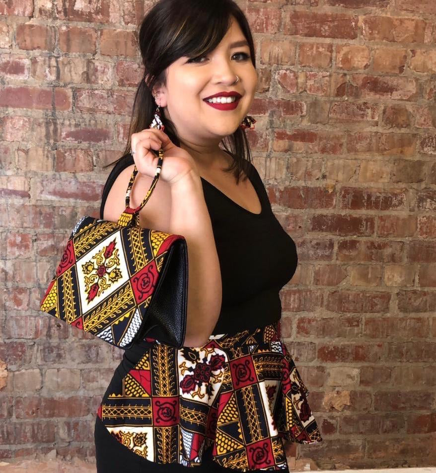 African print peplum belt hand-made from red, yellow, white and black ankara wax print in a geometric pattern