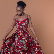 Load image into Gallery viewer, Red floor-length African print dress in floral pattern featuring a sweetheart neckline and off-shoulder straps. This dress can be coupled with a matching cape belt.