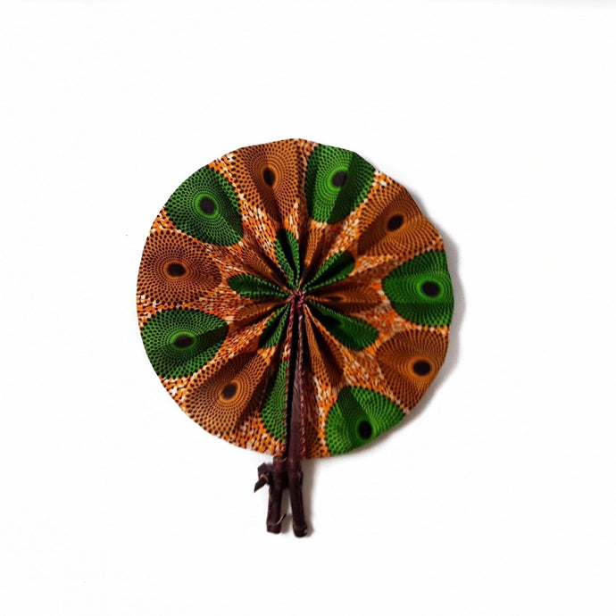 Expanded African print fan made from orange and green ankara wax print with dark brown leather clasp