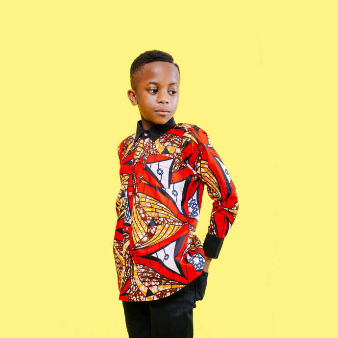 African print collared shirt made from red, orange and white ankara wax print with black crepe on the collares and sleeves