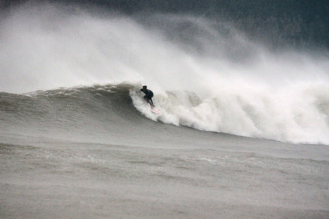 surfing in typhoon wave