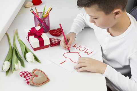 boy writing a note to mom