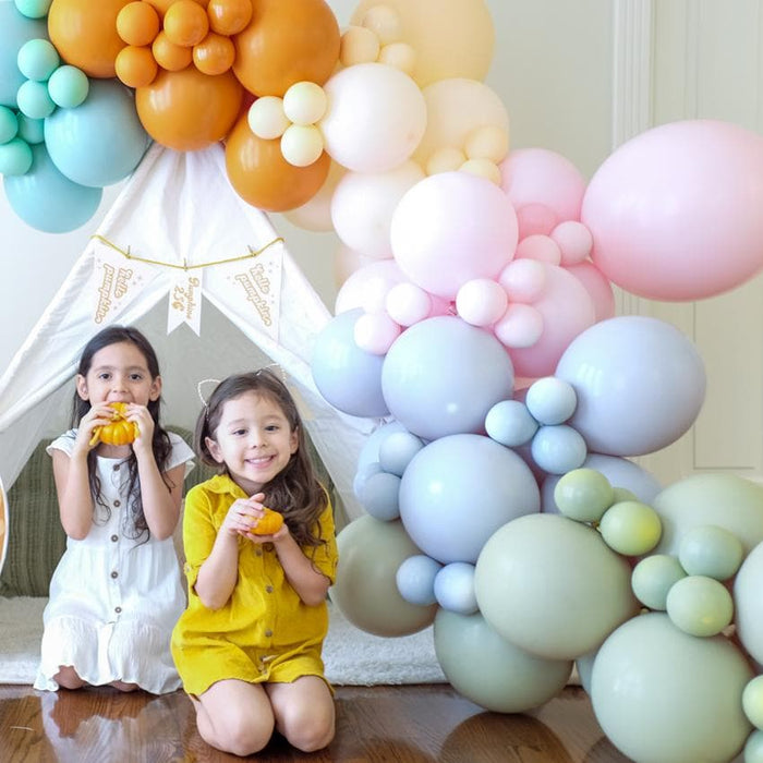 fall balloon garland with 2 girls