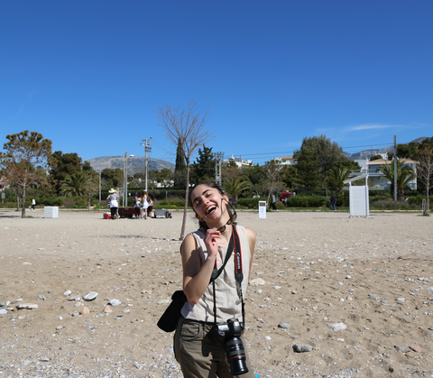 Greece, Anisa smiling at the camera, photography