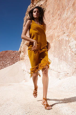 Athina running in flat gladiator leather sandals in brown at the stone quarry