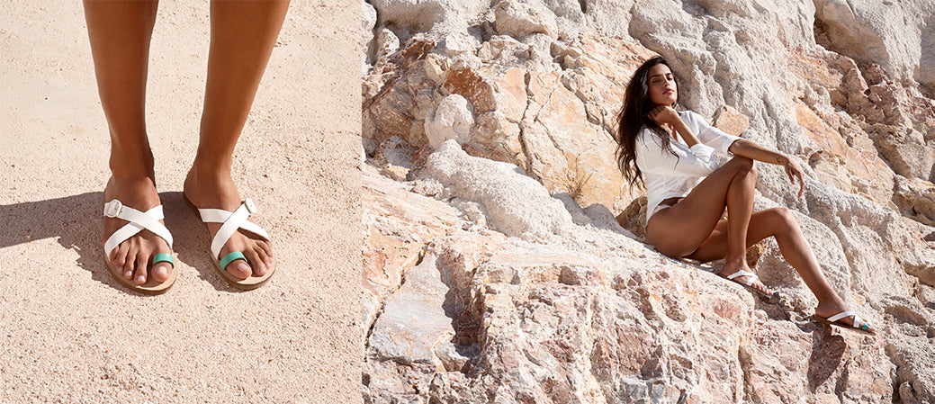 2 shots next to each other. Close up of mint and white slide on sandals with a toe loop. Athina wearing Greek sandals in stone quarry