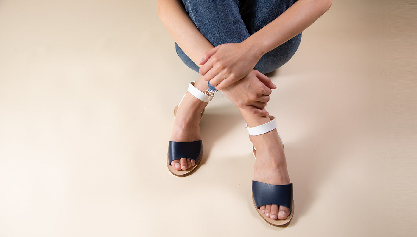 Model wearing Greek leather sandals with a block heel
