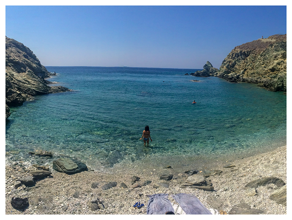 Swimming at a secluded beach on Folegandros island in Greece