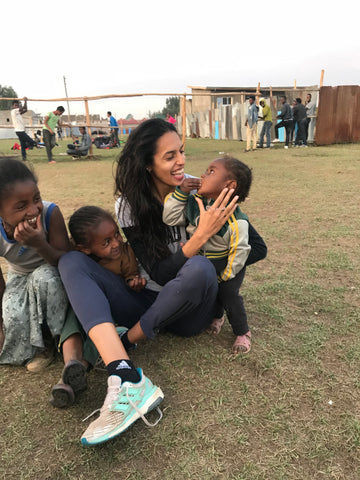 Athina in Ethiopia surrounded by children