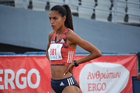Athina, professional runner, at a track preparing for a race