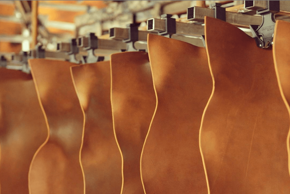 Vegetable-tanned premium Italian leather at the tannery, hanging
