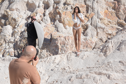 Athina wearing white and mint flat sandals at stone quarry during our photoshoot