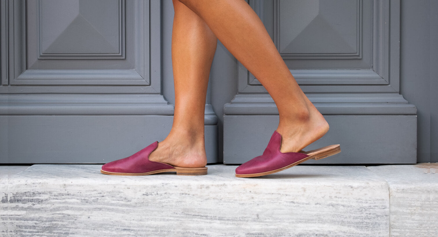 Our leather, handmade mule slides in berry