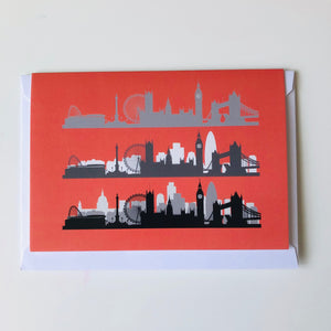 London Skyline greeting card - coral background