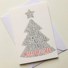 Christmas card tree shape, Merry Christmas in ENGLISH, SPANISH, FRENCH, ITALIAN, PORTUGUESE, FINNISH, DANISH, ROMANIAN, POLISH, GERMAN