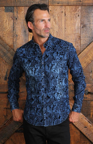 man in denim paisley shirt