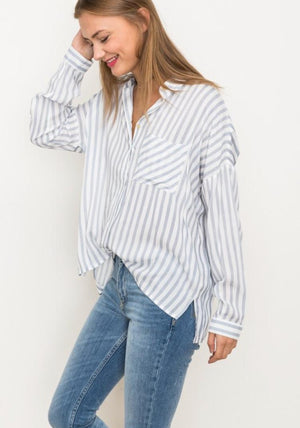 side view of women in tucked in button down shirt