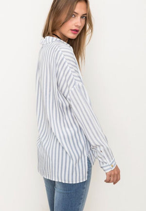 young woman in untucked striped shirt