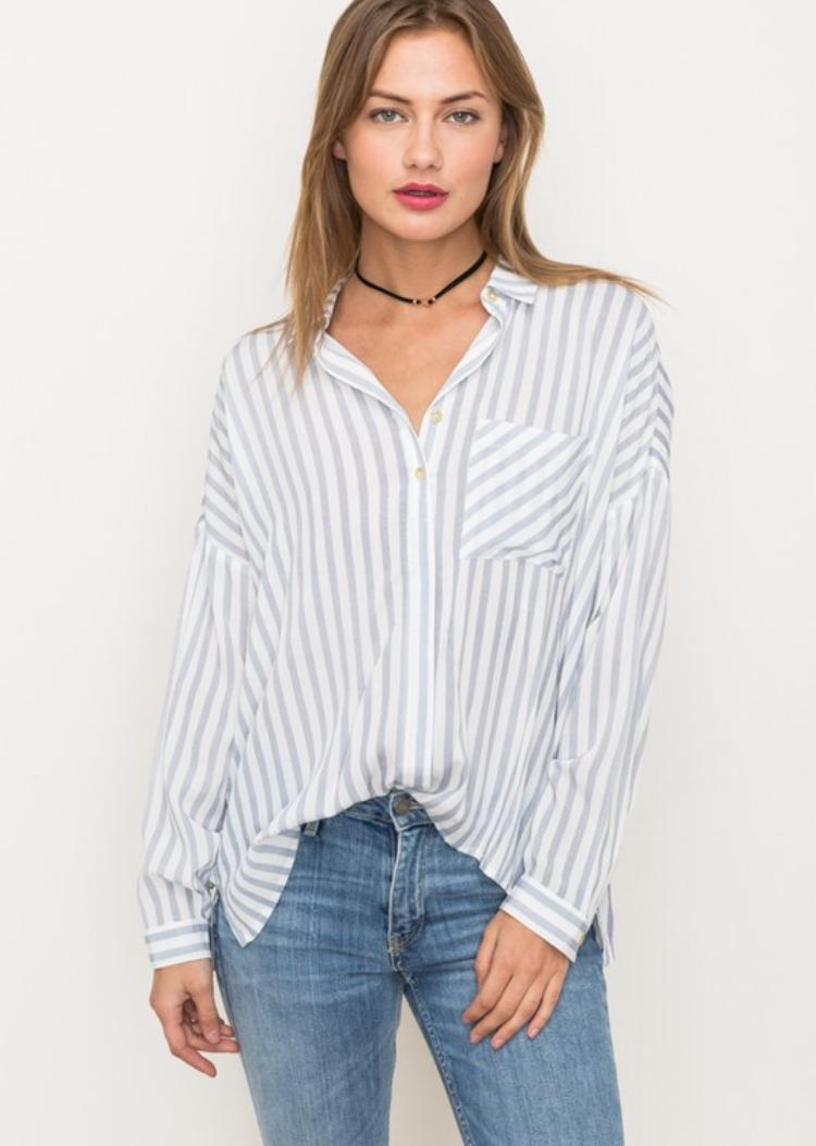 pretty girl facing front in blue and white button down shirt
