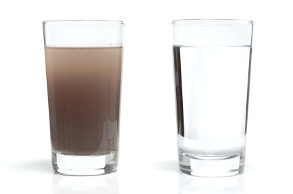 Two glasses of water - one very turbid, the other clear