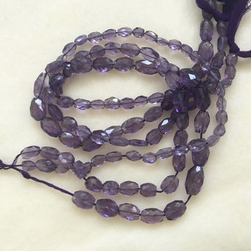 Amethyst Faceted Flat oval Bead Strand (AME-G036)