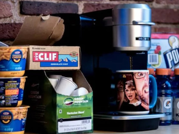 Coffee pods surrounded by other groceries. Photo: Jackson Ruckar