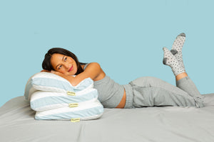 Woman with custom pillows from Pluto
