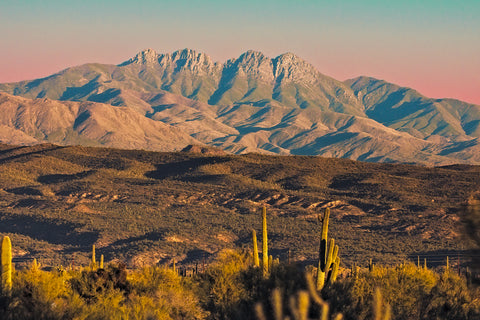 A landscape photograph of the Four Peaks mountain range at sunset.