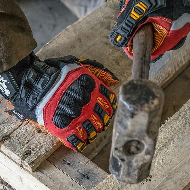 Worker using gripping gloves with strong grip material to hold hammer