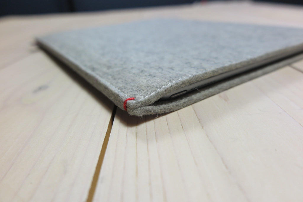 Grey wool felt iPad Pro case with a red detail