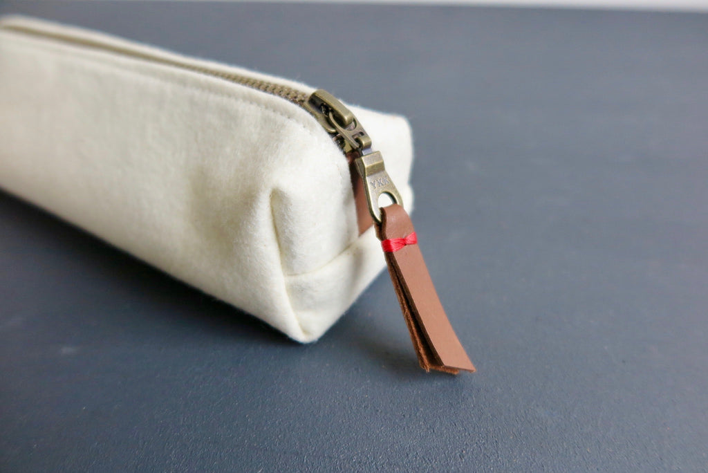 Leather pull tab on our YKK zipper pencil case