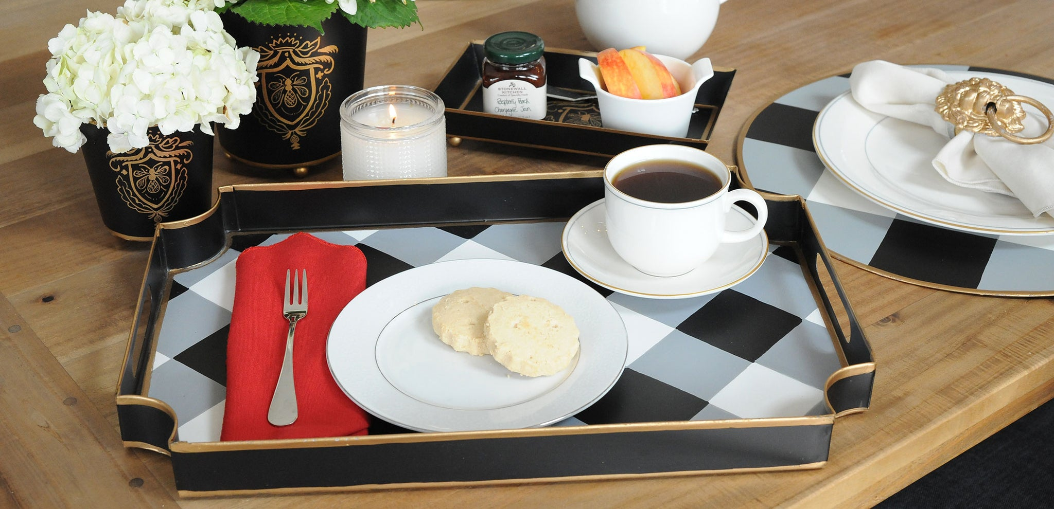 Jaye's Studio trays, chargers, placemats, and other tabletop items.