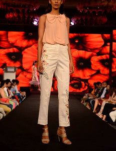 Blush pink top wit a bow and embroidered trouser.