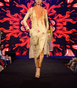 beige and gold kurta set with pants and chiffon scarf.