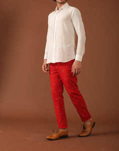 white shirts and printed red trousers