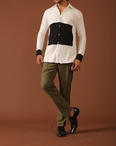 White shirt  and olive green trousers