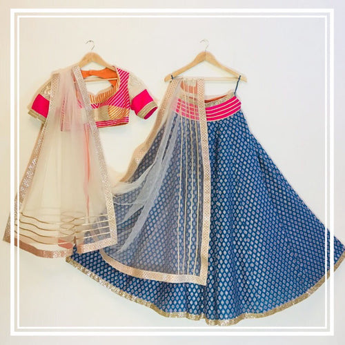 Color block gota line choli, peacock blue brocade lehenga and cream tulle dupatta